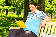 Pregnant Woman With Book Stock Photography