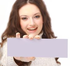 Young Woman Holding An Empty Billboard Royalty Free Stock Images