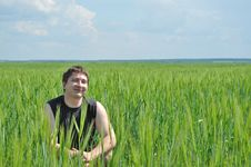 Free A Man Sits In A Field Of Green Wheat Stock Image - 14576941