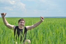 Free A Man Sits In A Field Of Green Wheat Stock Photography - 14577012