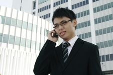Free Asian Businessman Talking On The Phone Royalty Free Stock Photo - 14577985