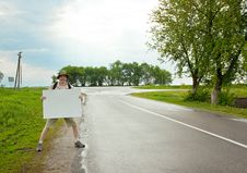 Free Tourist On A Country Road Royalty Free Stock Image - 14579576