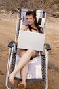 Free Woman With Laptop On The Beach Stock Image - 14584881