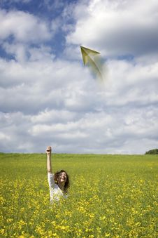 Woman In Rapeseed Field Throwing A Paper Plane Stock Photography