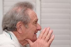 Free Smiling Elderly Man Resting His Head On Hands Stock Photos - 14581523