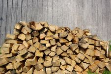 Free Freshly Cut Firewood In Front Of Grey Barn Wall Royalty Free Stock Photography - 14583797