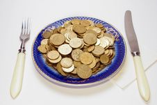 Plate Of Coins On White Background Stock Images