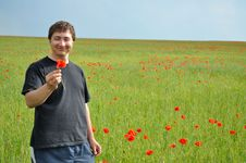 Free A Young Man Holds A Poppy Flower Stock Photo - 14585430