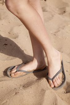 Feet In Sand Showing Legs Royalty Free Stock Images