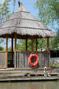 Free Wooden Pavilion And Dog On Quay Royalty Free Stock Photography - 14594067