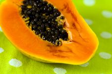 Cut Up Papaya Fruit On Green Background Stock Photo
