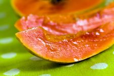 Cut Up Papaya Fruit On Green Background Royalty Free Stock Image