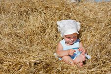 Free Toddler Girl Playing In Haystack Stock Image - 14593531