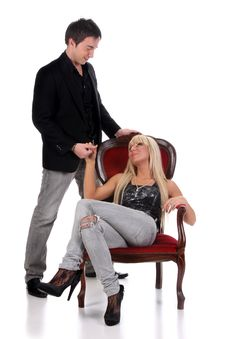 Young Man And A Woman Sitting On A Chair Royalty Free Stock Photos
