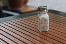 Free Salt Shaker On Wooden Table Royalty Free Stock Photos - 14599238