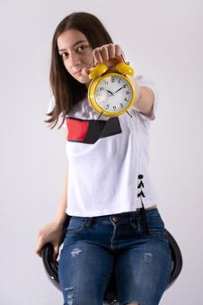 Free Young Girl With Retro Clock In Hand Showing Time On Yellow Clock Isolated On White Background Royalty Free Stock Images - 145950039