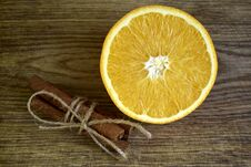 Ripe Orange, Cinnamon Sticks On Wooden Surface Stock Photo