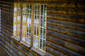 Free Fall Foliage Reflected In Window Of Log Home Royalty Free Stock Image - 1461476