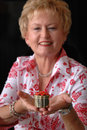 Free Mature Woman With Christmas Gift Royalty Free Stock Photography - 1461707