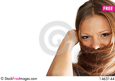 Young woman playing with hair. isolated. Stock Photo