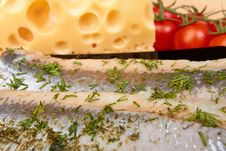 Herring On Plate With Piece Of Cheese And Tomato Royalty Free Stock Photos