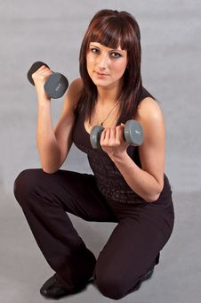 Free Woman Lifting Weights Royalty Free Stock Image - 14604786