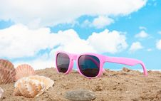 Pink Sunglasses And Shells Stock Photography