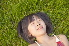 Asian Girl Lying Down Royalty Free Stock Image