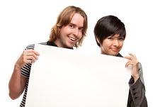 Free Attractive Diverse Couple Holding Blank White Sign Stock Photos - 14606663