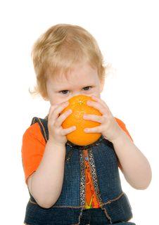 Free Child Bites Orange Royalty Free Stock Photos - 14606948