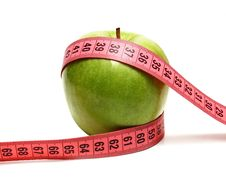 Free Green Apple And Measuring Ribbon For Diet Royalty Free Stock Photos - 14609368