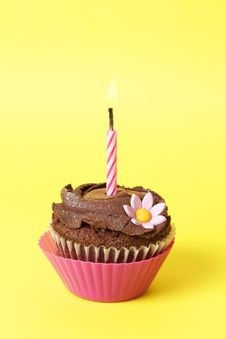 Miniature Chocolate Cupcake With Candle Royalty Free Stock Photos