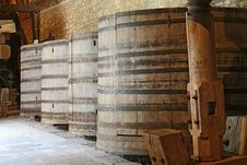 Wine Barrels Stacked In The Cellar Royalty Free Stock Image