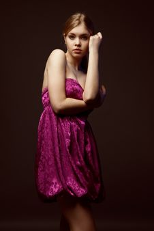 Seductive Young Woman Wearing Pink Dress Royalty Free Stock Image