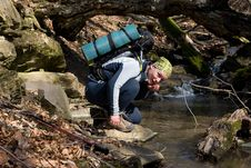 Free Hiker Drinking From A Stream Royalty Free Stock Images - 14622729