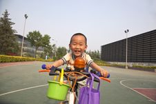 Free Asian Boy Riding Bike Stock Image - 14623561