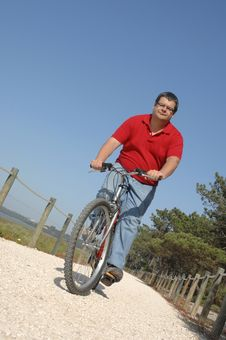 Cycler On The Seaside Walking With Bike Stock Photos
