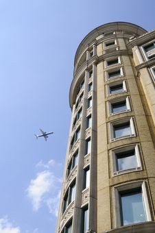Free Airplane And Vertical Building Royalty Free Stock Image - 14624036