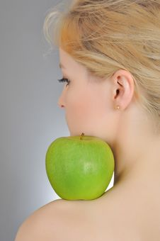Free Young Woman Holding Green Apple On  Her Shoulder Royalty Free Stock Images - 14624979