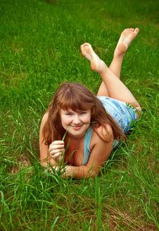 Free Woman Holding A Blade Of Grass Stock Image - 14626431