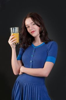 Free Beauty Woman In Blue Dress With Yellow Orange Juic Royalty Free Stock Photos - 14626668
