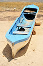 Free Blue Canoe On Beach Royalty Free Stock Images - 14635729