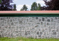 Free Stone Wall With Red Roof Stock Photo - 14636880