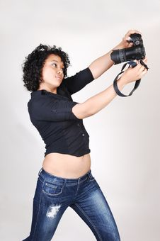 Young Girl With Camera. Royalty Free Stock Photos