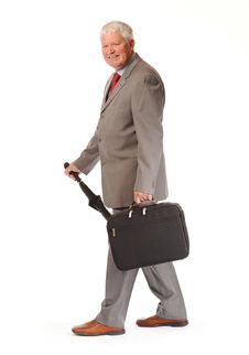 Mature Businessman With Umbrella And Briefcase Stock Image