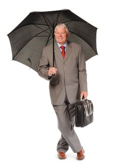 Mature Businessman With Umbrella And Briefcase Royalty Free Stock Image