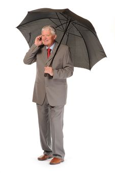 Successful Businessman With Umbrella And Phone Royalty Free Stock Photos