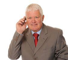 Free Successful Mature Businessman Using Phone Stock Photography - 14636772