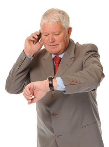 Successful Mature Businessman Using Phone Royalty Free Stock Photography