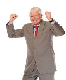 Successful Mature Businessman Celebrating Stock Photography